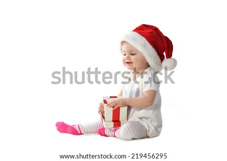 adorable baby girl in Santa hat  with  gift box - stock photo