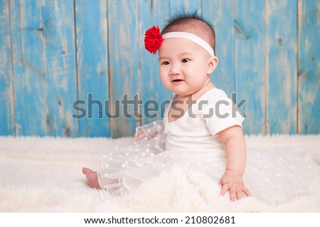 Adorable baby girl in white dress - stock photo