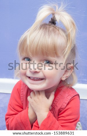 Adorable baby girl laughing happily - stock photo