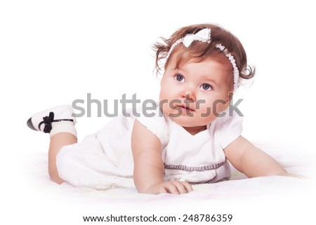 Adorable baby girl lying on the blanket - stock photo