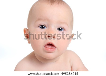 Adorable baby girl on blanket in pampers on a white background