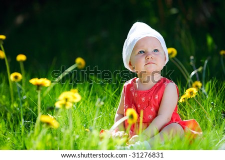 Adorable baby girl outdoors at sunny summer day - stock photo
