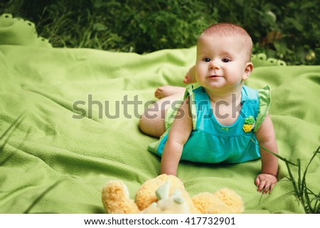 Adorable Baby Girl Playing and Having Fun - stock photo