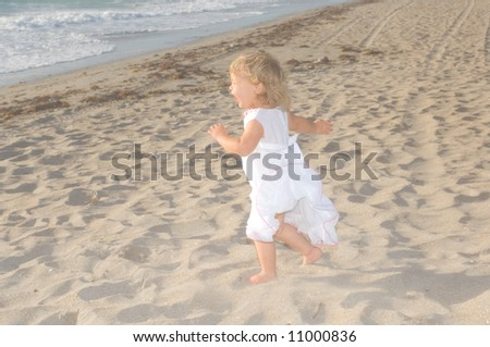 Adorable Baby Girl Playing on the Beach - stock photo