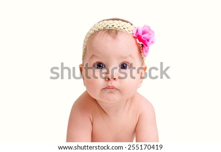 Adorable baby girl portrait with flower isolated on white background - stock photo