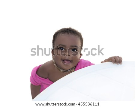 Adorable baby girl smiling, nine months old, isolated