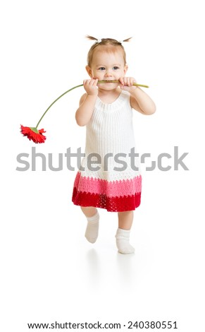 Adorable baby girl walking with flower in mouth isolated - stock photo