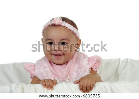 Adorable baby girl wearing a pink dress - stock photo