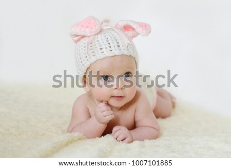 adorable baby girl wearing knitted hat with ears