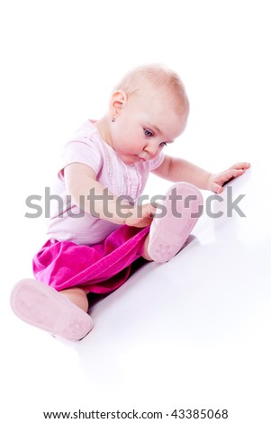 Adorable Baby girl wearing pink suite