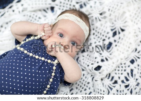 adorable baby girl wearing white dress - stock photo