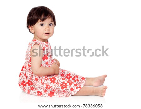 Adorable baby girl with floral dress isolated on a over white background