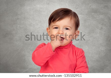 Adorable baby girl with the hands in her mouth - stock photo
