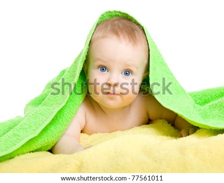 Adorable baby in colorful towel - stock photo