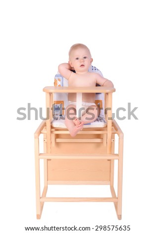 Adorable baby in high chair isolated on white - stock photo
