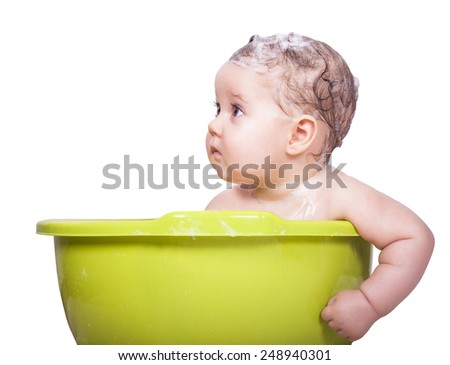 Adorable baby in the bathtub - stock photo