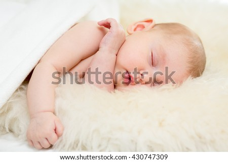adorable baby infant sleeping on soft bed - stock photo