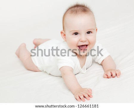 Adorable baby laughing - stock photo