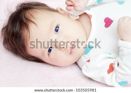 Adorable baby looking at camera (two months old)