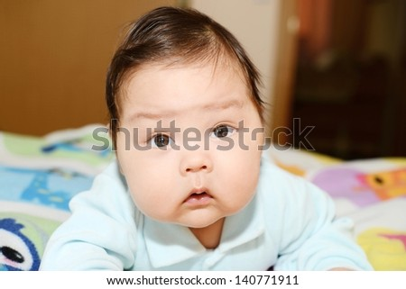 Adorable baby lying on the bed