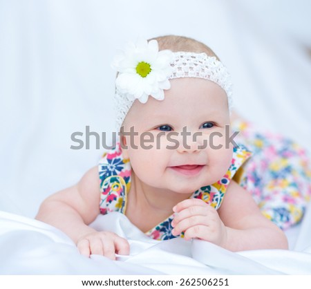 Adorable baby 5 months, close-up portrait - stock photo