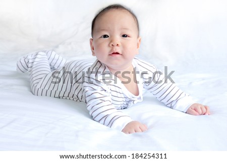 adorable baby on light blue blanket - stock photo