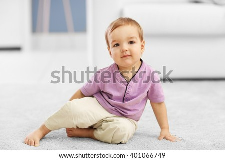 Adorable baby on the floor in the room