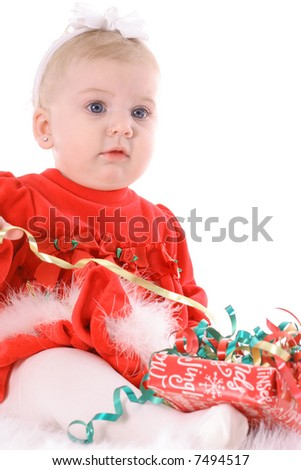 adorable baby opening presents - stock photo