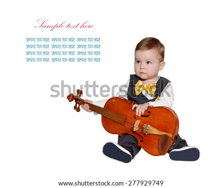 adorable baby playing violin. Wearing classic vest and colorful bowtie and looking at sample text on white background - stock photo
