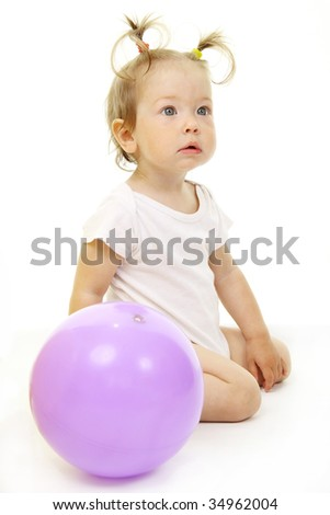Adorable baby playing with ball