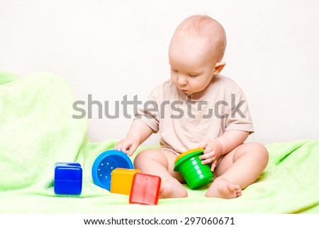adorable baby playing with colorful toys