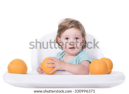 Adorable baby playing with oranges, healthy food concept - stock photo