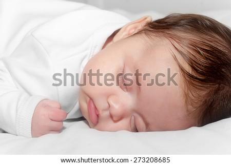 Adorable baby sleeping  - stock photo