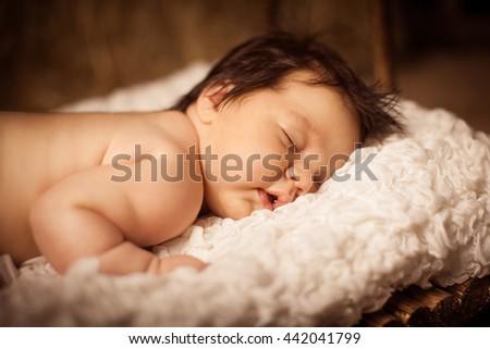 Adorable baby sleeping on stomach. Studio shot. - stock photo