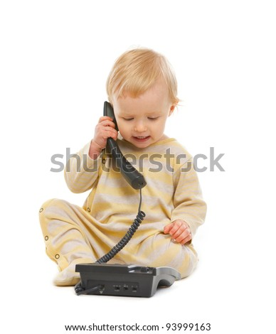 Adorable baby speaking on phone isolated on white
