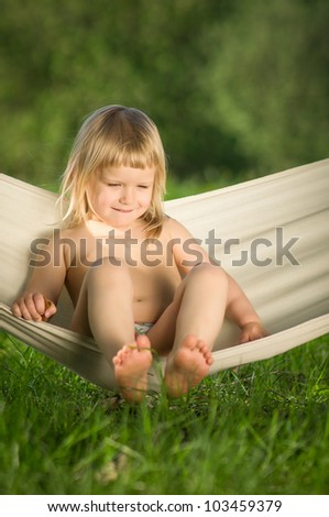 Adorable baby swing sitting in hammock - stock photo