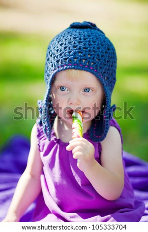 Adorable baby with colorful candy