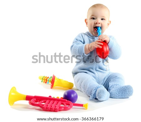 Adorable baby with plastic colourful musical toys isolated on white background - stock photo