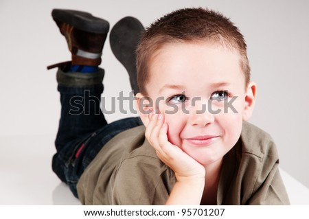 adorable beautiful child looking to the right - stock photo