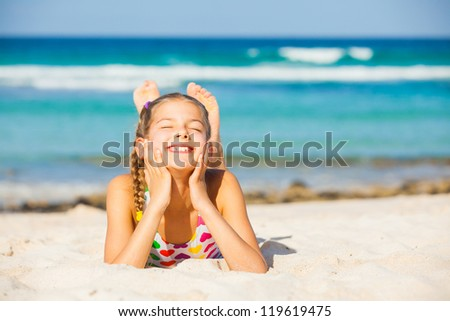 Adorable beautiful girl having fun on the tropical beach. Vertical view - stock photo