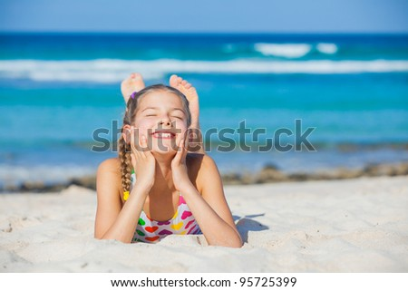 Adorable beautiful girl having fun on the tropical beach. Vertical view