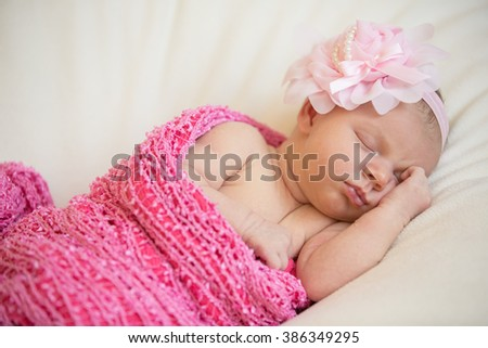 Adorable beautiful newborn baby girl. Maternity and newborn concept.