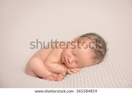Adorable beautiful newborn baby girl. Maternity and newborn concept. Newborn baby is sleeping - stock photo