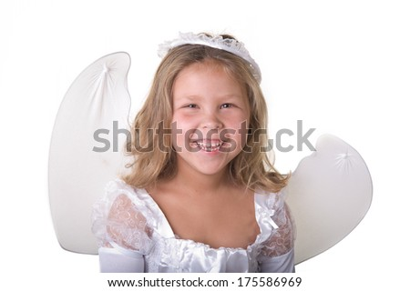 Adorable blond girl smiling wearing an angel costume for Halloween in the studio  - stock photo