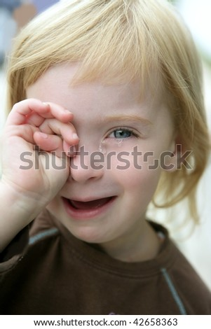 Adorable blond little girl crying closeup portrait - stock photo