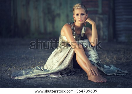 adorable blond woman in an elegant dress - stock photo
