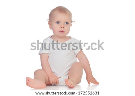 Adorable blonde baby in underwear sitting on the floor isolated on a white background
