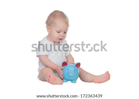 Adorable blonde baby in underwear with a blue moneybox isolated on a white background