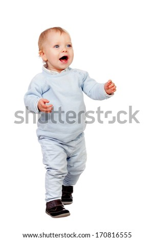 Adorable blonde baby walking isolated on white background - stock photo