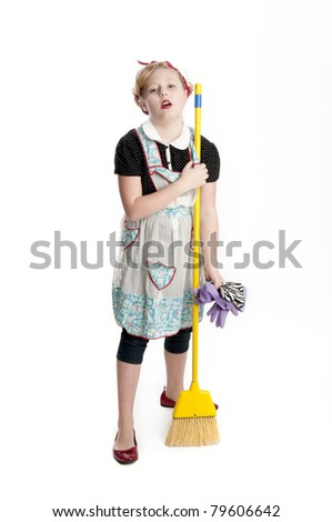 Adorable blonde child model wearing retro apron holding a broom